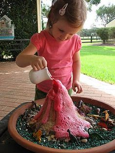 Make your own reusable tray for a homemade volcano.  Use ceramic tray for potted plant.  Hot glue gravel and plastic dinosaurs around edges leaving circle in middle.  Glue plastic bottle in center.  Then build volcano from sand and put appropriate ingredients in bottle to create volcano.  When done rinse everything and repeat another day.