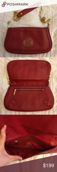 Authentic Tory Burch clutch/shoulder bag Authentic Tory Burch clutch/shoulder bag. EUC.  Small wear on corner as pictured.  Includes dust bag.  Beautiful red leather with gold chain. UGG Bags