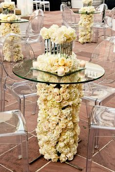 cocktail tables adorned with floral legs & floral centerpieces <3