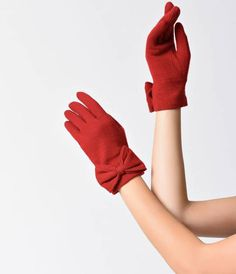 Add a look of vintage elegance to any outfit with these short red gloves from Unique Vintage and youll feel like retro refinement all evening long. The lightweight angora wool feels comfortable against the skin, while a subtle bow adds a noble style. Wit