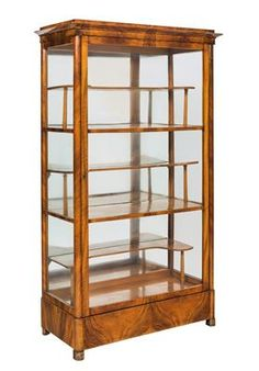 Biedermeier vitrine,  Austria circa 1820. Made in walnut, the rounded angles with crossbanded veneer, fine maple fillets, glazing on three sides, one drawer, one door, maple shelving and mirror on the back panel. 162 x 92 x 44 cm. Some ageing, one shelf replace,