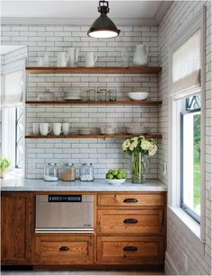 Open shelving and rustic cabinets contrast beautifully with sleek subway tile.