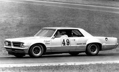 Bob Tullius at the wheel of the Gray Ghost at Mid-Ohio in 1971. Herb Adams created this '64 Pontiac Tempest for the '71 Trans-Am series.
