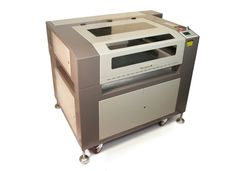 LS-1630 laser cutter w/ 5 way material pass through options...up to 120W of laser power.