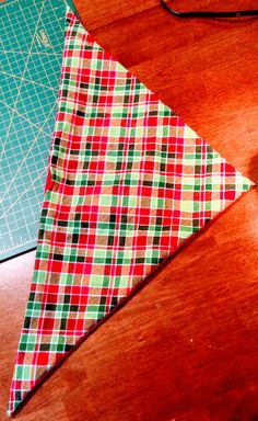 Today's project was a dog bandana. I like making these reversible. This one is Christmas themed and I'm making it for a friend. You will need two triangles of fabric. Size of triangles …