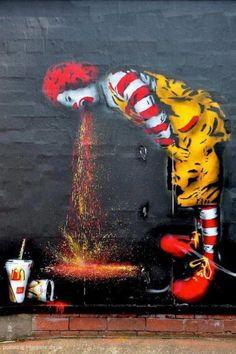 Ronald McDonald Puking Food After Eating at McDonalds!  -Banksy, street art, graffiti.