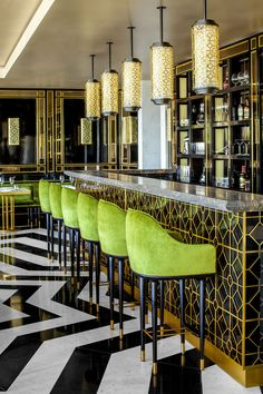 olive hues, mixed brass + marble, a striped marble floor...loving the contrast of colors + patterns in this gorgeous bar