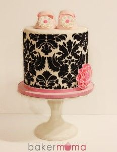 Damask baby shower cake love it...not sure about booties though.