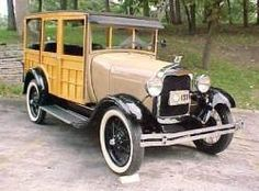 1929 Ford. Love the beige color and wood.