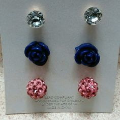New  Earrings. 3 pack New. Never been worn. Not real diamonds. The Rose earrings are dark purple. The last earrings are pink. Charlotte Accessories Jewelry Earrings