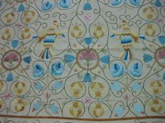 Castelo Branco silk embroidery designs date from the 12th century. It is a luxury product, bespoke handmade by artisans, using linen made on a loom and embroidered with silk threads.