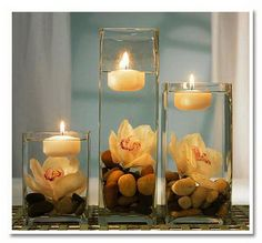 multiple small flower arrangements | Floating -Flowers- And -Candles -Centerpieces_096