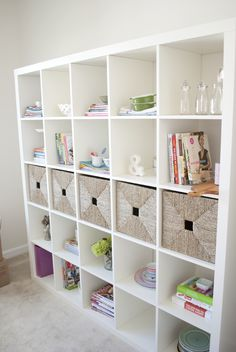 I love this full wall shelving unit.The wicker baskets are such a nice touch.