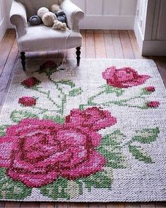 Cross stitch on ugly old rug to make it better?