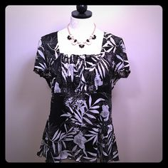Style & Co. Black & White Floral Top! EUC, no rips, stains or tears. From Style & Co., a flowy short sleeve top that would be excellent in the warmer months or as a layering piece. Empire waist with black shell lining and a feminine overlay that has a pretty floral print. Square neckline with ruffle at bottom of neckline and also around the hem of the top. Size: XL. I was XL when wearing it so feel it is true to size. 100% polyester. **Black & white statement necklace also available for sale…
