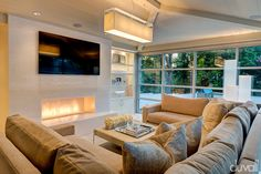 Modern Family Room Addition with Crystal Quartz Fireplace - Duvall Architecture & Interiors