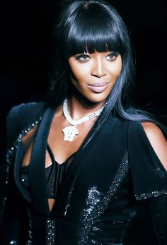 Naomi Campbell opening Atelier Versace Fall 2013.