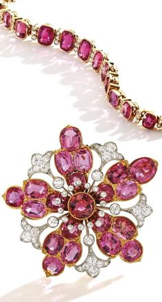 GOLD, PLATINUM-TOPPED GOLD, PINK TOURMALINE AND DIAMOND BROOCH, DESIGNED BY PAULDING FARNHAM FOR TIFFANY & CO. The openwork flowerhead centering a round pink tourmaline weighing approximately 1.70 carats, accented by 20 oval-shaped pink tourmalines weighing approximately 9.10 carats, further set with old European-cut diamonds weighing approximately 2.40 carats, gross weight approximately 15 dwts, signed Tiffany & Co., with scratch number 845; circa 1900.