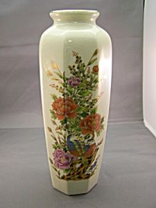 Nice porcelain vase with floral and bird design and crazed finish. 11 inches tall. Made by OMC, Japan. Circa 1960s. Free of damage. Signed with a kanji on base.