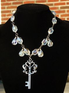 Statement necklace with big crystal glass beads and a big key by The Black Cat Designs