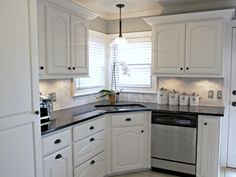 creating a strong contrast to the white backsplash and cabinets