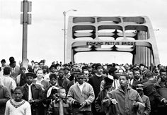 Civil rights activists march across the Edmund Pettus Bridge in Selma, Ala., on March 7, 1965, on their way to Montgomery, the state capital. They are demanding voter registration rights for blacks, who are discouraged and many times threatened with violence if they try to vote, particularly in small towns in the South.