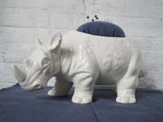 Pin cushion made from novelty floral container - Rhinoceros pincushion TUTORIAL by Indietutes Pincushion Tutorial, Sewing Notions, Pin Cushions, Easy Crafts, Lion Sculpture, Container, Rhinos, Rhinoceros, Crafty