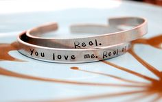 You love me, real or not real?  Real.
