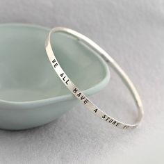 Handmade in Brighton, UK, and hand-stamped with your message | Personalised Script Sterling Silver Bangle | GettingPersonal.co.uk