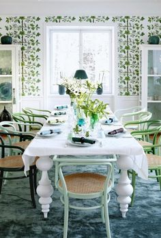 What a bright and fresh green dining room. Love the wallpaper.