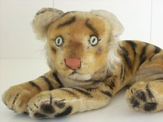 vintage steiff tiger - I still have mine - his name is Lambert.