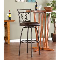 The design of the Lyndon adjustable counter/ bar stool and hammered brass finish make this great for traditional to modern homes. The seat features a foam cushion covered in dark brown vinyl; a full 360 degree swivel and footrest add to the comfort.