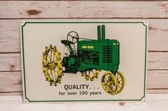 A personal favorite from my Etsy shop https://www.etsy.com/listing/287300399/vintage-john-deere-tractors-tin-sign