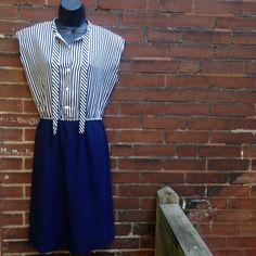 """Vintage Navy Striped Melissa Lane Dress Vintage Melissa Lane striped mini dress that ties at the neck. Navy/white striped on the top with a navy skirt. Some pilling on skirt.2nd button from the top missing. Bust 38 Waist 28-30"""" Hip 40. Total length 41"""" Vintage Dresses"""