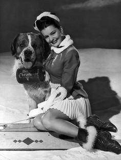 Could Cy Charisse or that darling St. Bernard look any more adorable? I think not :) #vintage #pinup #actress #winter #snow #Christmas #1940s #forties #Hollywood #dog #cute #St_Bernard
