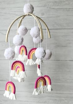 This unique Macrame Rainbow Baby Mobile is the inspiration piece you've been looking for! Hang it in the nursery or playroom for a fun pop of color and texture. Available in a variety of different colors at Motley Bliss on Etsy! Macrame Art, Macrame Projects, Baby Girl Nursery Decor, Boho Nursery, Nursery Wall Decor, Playroom Decor, Rainbow Baby, Rainbow Nursery, Macrame Patterns