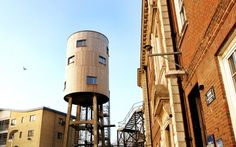 An Apartment in a Water Tower. This would be a dream in New York City. I'd love to refurbish an old tower on top of a tall building in nyc.