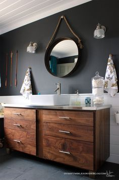 beautiful wood on the vanity. I like the white tile behind with round mirror and square vessel sink (not too tapered)