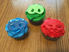 PJ Masks Birthday Cupcakes Coordinating with PJ Masks birthday cake.