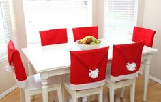 """ DIY Christmas Chair Covers What a fantastic DIY idea to bring life to any kitchen or dinning table! This DIY Christmas Chair Covers will not only bring the holiday spirit to any room but. Christmas Centerpieces, Christmas Decorations To Make, Holiday Crafts, Christmas Ornaments, Christmas Chair Covers, Natal Diy, Deco Table Noel, Christmas Sewing Projects, Diy Projects"