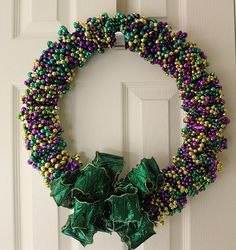 Mardi Gras Bead Wreath Tutorial.finally something to do with all the parade beads. Need to do one for Easter and summer, seperate the colors!