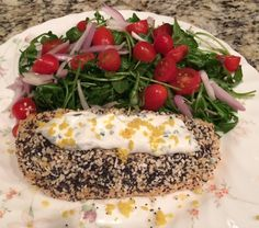 Salmon Crusted with Everything Bagel Seasoning with Chive Sour Cream, Arugula Salad & Lemon Caper Vinaigrette