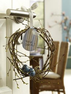 love the pussy willow wreath with 2 egg shells painted blue & black speckles - hang from fence or tree