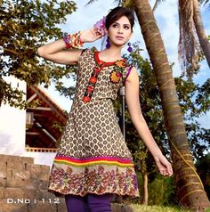 Cotton Kurti top in beige and black print with multicoloured embroidery on the hem, shoulder and neckline. £29.99