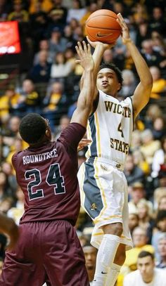 Wichita State's Corey Henderson (4) shoots against Missouri State's Shawn Roundtree in the second half at Koch Arena Saturday. (Feb. 7, 2015)