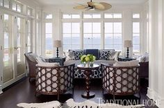 In a sunroom near the pool, furniture is covered in water-resistant indoor-outdoor fabrics the colors of sand and sea. - Traditional Home ® Photo: Tria Giovan / Design: Ken Gemes Porch Furniture, Living Room Furniture, Outdoor Furniture Sets, Rattan Furniture, Fresco, Sunroom Windows, Windows 10, Traditional Home Magazine, House With Porch