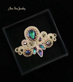 A personal favorite from my Etsy shop https://www.etsy.com/listing/506021080/soutache-green-purple-brooch-made-from