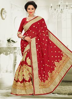 Be the sunshine of anyone's eyes dressed in such a charming red georgette designer saree. Beautified with embroidered, patch border and zari work all synchronized nicely with the pattern and style a...
