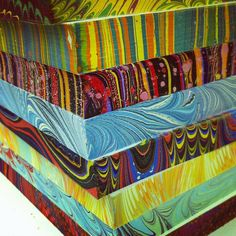 This picture shows all of the marbled book blocks that each student made. Wouldn't mind learning how to do this!