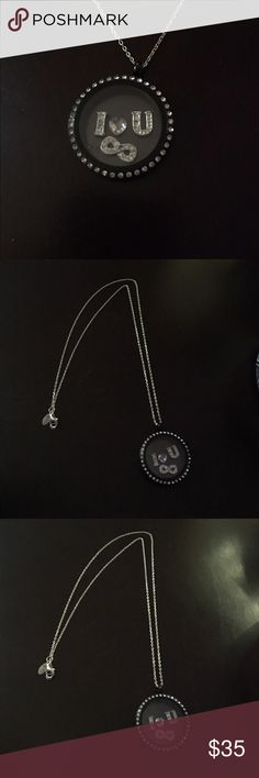 Origami owl locket Origami owl locket with Swarovski crystals, and 4 charms included (an I, a heart, an U, and an infinity sign) on a silver chain.   *or best offer* origami owl Jewelry Necklaces